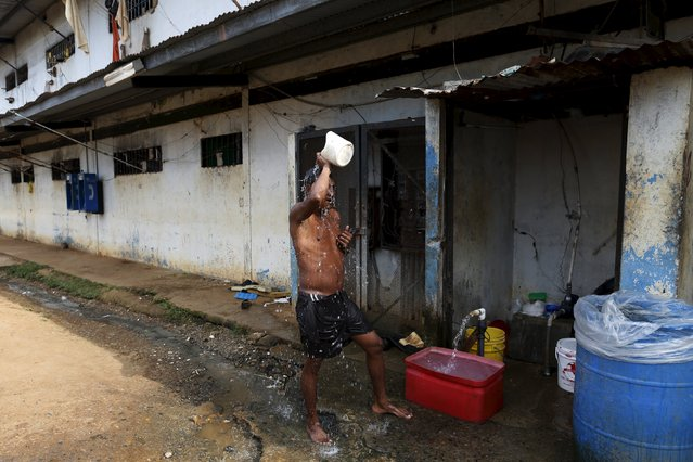 An inmate washes himself in a courtyard in La Joya prison on the outskirts of Panama City, Panama January 27, 2016. (Photo by Carlos Jasso/Reuters)