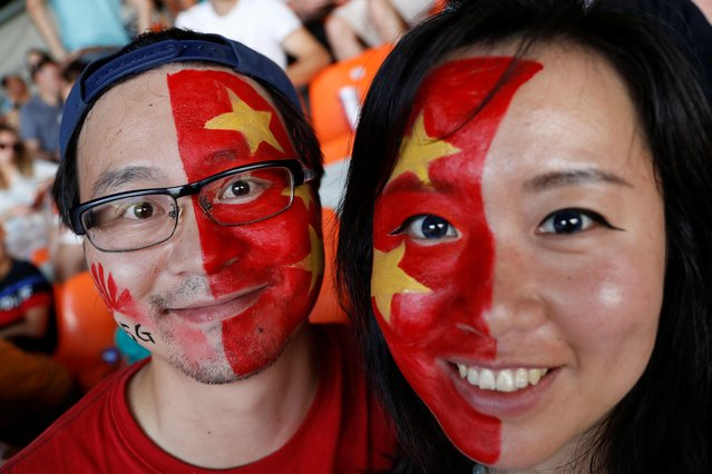 Fans of China cheer during the 2019 FIFA Women's World Cup France Round Of 16 match between Italy and China at Stade de la Mosson on June 25, 2019 in Montpellier, France. (Photo by Eric Gaillard/Reuters)