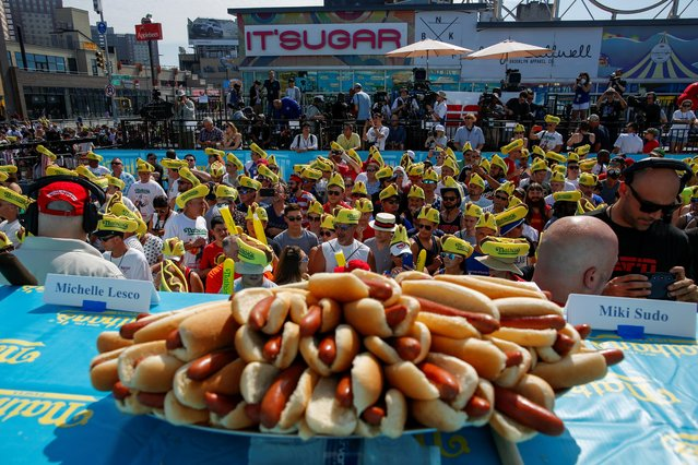 People attend the Nathan's Famous Fourth of July International Hot Dog-Eating Contest at Coney Island in Brooklyn, New York City, U.S., July 4, 2019. (Photo by Eduardo Munoz/Reuters)