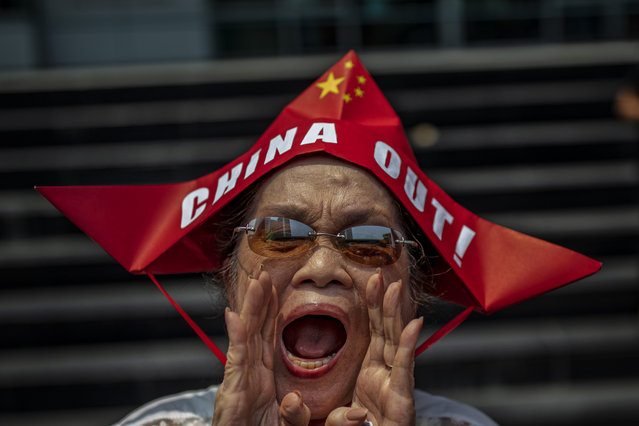 A Filipino shouts slogans as he takes part in an anti-China protest outside the Chinese Embassy on July 12, 2019 in Makati, Metro Manila, Philippines. Protests marked the third anniversary of the Hague's Permanent Court of Arbitration decision on the West Philippine Sea, which in 2016 ruled in favor of the Philippines and rejected China's claims on the disputed waters. On Monday, President Rodrigo Duterte dared the US to declare war on Chinese forces in the West Philippine Sea, arguing that the US should support the Philippines with military force if China does not respect international shipping lanes. The statement comes amidst rising tensions in the region, just weeks after the sinking of a Filipino fishing boat by a Chinese fishing vessel at the Reed Bank tablemount part of the Philippine Exclusive Economic Zone which left all 22 Filipino crew floating at sea before being rescued by a nearby Vietnamese fishing vessel. President Duterte later sided with the Chinese vessel, and announced that China will continue to fish even in waters that fall under Philippine territory. (Photo by Ezra Acayan/Getty Images)