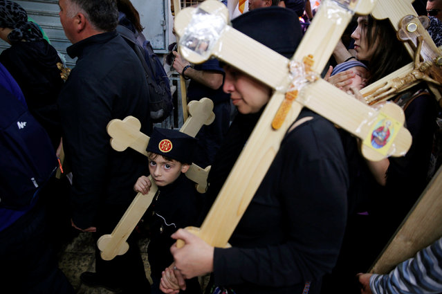 Orthodox Christian worshippers from Serbia hold crosses as they walk along Via Dolorosa during the Holy Week Good Friday procession in Jerusalem's Old City April 29, 2016. (Photo by Ammar Awad/Reuters)