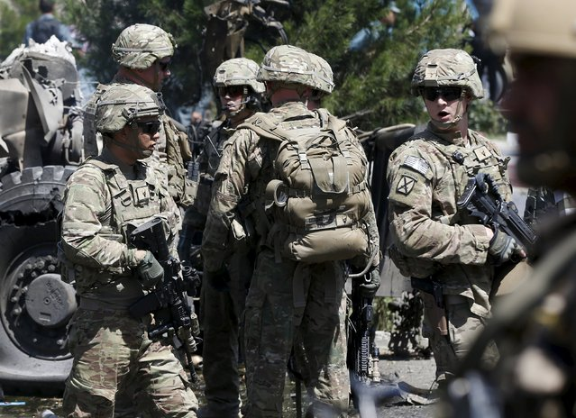 U.S. troops arrive at the site of a suicide bomb attack in Kabul, Afghanistan, June 30, 2015. (Photo by Omar Sobhani/Reuters)