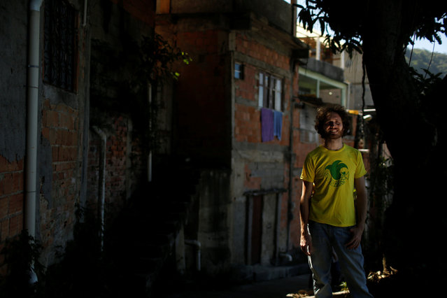 British musician Tom Ashe poses for a photograph near the building where he is renting a room, in Pereira da Silva favela, in Rio de Janeiro, Brazil, May 2, 2016. (Photo by Pilar Olivares/Reuters)