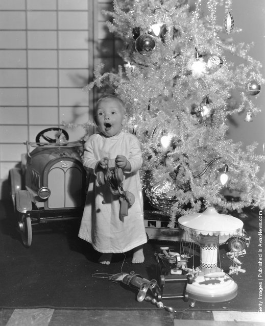 1933: One-year-old Paramount child star Baby LeRoy plays with his new toys under the Christmas tree