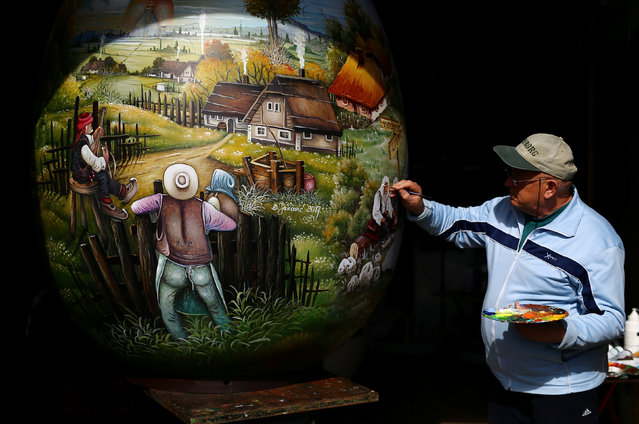 A local artist paints a two-metre-high Easter egg in the traditional naive art style in Koprivnica, Croatia, March 9, 2017. (Photo by Antonio Bronic/Reuters)