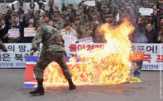 Protesters burn the North Korean flag during a rally at Seoul Station on December 28, 2011 in Seoul, South Korea