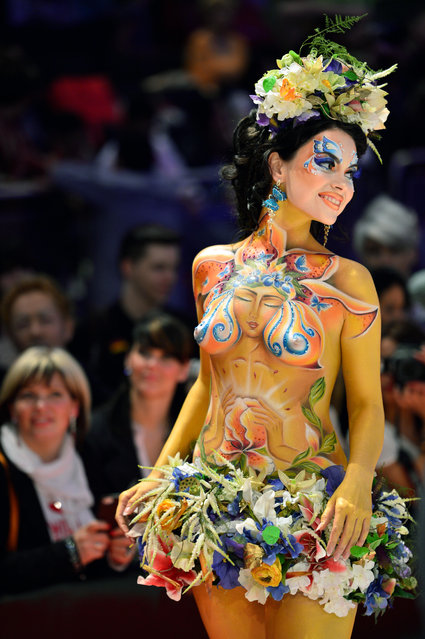 "A model poses on the catwalk after the contest ""Body Painting"" of the OMC Hairworld World Cup on May 4, 2014 in Frankfurt am Main, Germany. The OMC Hairworld World Cup will be held in Frankfurt from 3 to 5 May 2014, parallel to the Hair and Beauty 2014 fair. Around 1.250 participants from 50 countries will be fighting it out for the title. (Photo by Thomas Lohnes/Getty Images)"