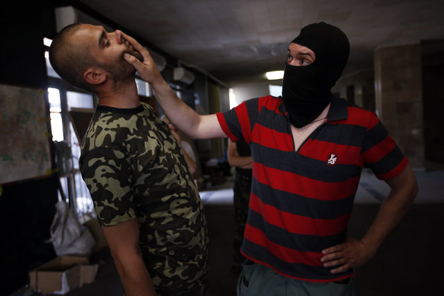 New recruits to the pro-Russian activist movement undergo basic training in the district administration building, central Donetsk, Eastern Ukraine May 18, 2014. (Photo by Maxim Zmeyev/Reuters)