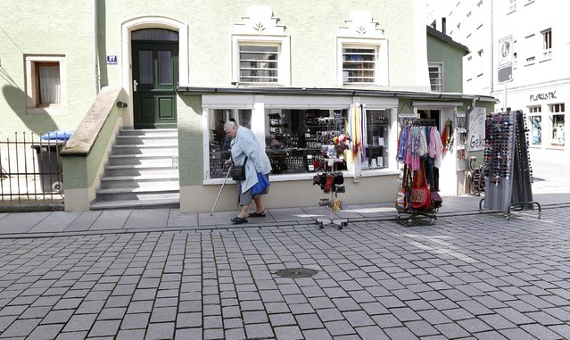 """A woman passes Petra Breitenfellner's shop, """"Geko"""", in the centre of Passau, May 19, 2014.  REUTERS/Michaela Rehle"""