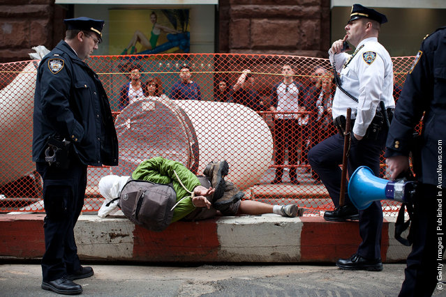 An Occupy Wall Street protestor is arrested by the police during a march from Zuccotti Park to Union Square