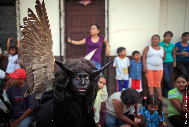 A man performs as a devil during a Holy Week Via Crucis in Masaya, Nicaragua on Thursday