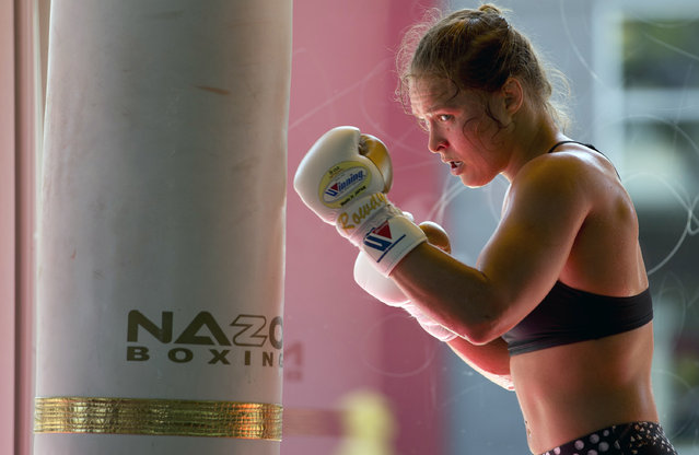 """This July 15, 2015, file photo shows mixed martial arts fighter Ronda Rousey working out at Glendale Fighting Club in Glendale, Calif. Paramount Pictures said Monday, August 3, that it has acquired the rights to Rousey's autobiography """"My Fight/Your Fight"""", with plans for Rousey to play herself in the adaptation. (Photo by Jae C. Hong/AP Photo)"""