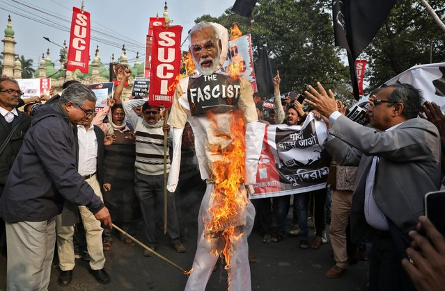 Activists of Socialist Unity Centre of India (SUCI) burn an effigy depicting India's Prime Minister Narendra Modi during a protest against his visit to the state and against a new citizenship law, in Kolkata, India, January 11, 2020. (Photo by Rupak De Chowdhuri/Reuters)