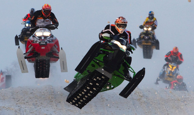 A rider on an Arctic Cat snowmobile leads others during the Canadian Snowcross Racing Association's (CSRA) Kawartha Cup in Lindsay, Ontario February 8, 2014. (Photo by Fred Thornhill/Reuters)
