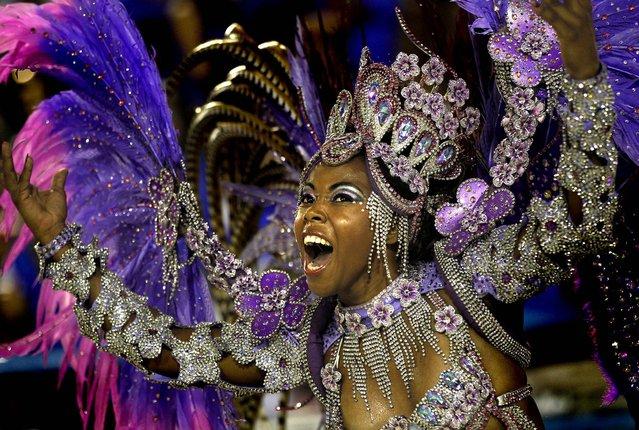 A performer from the Renascer de Jacarepagua samba school dances at the Sambadrome in Rio de Janeiro