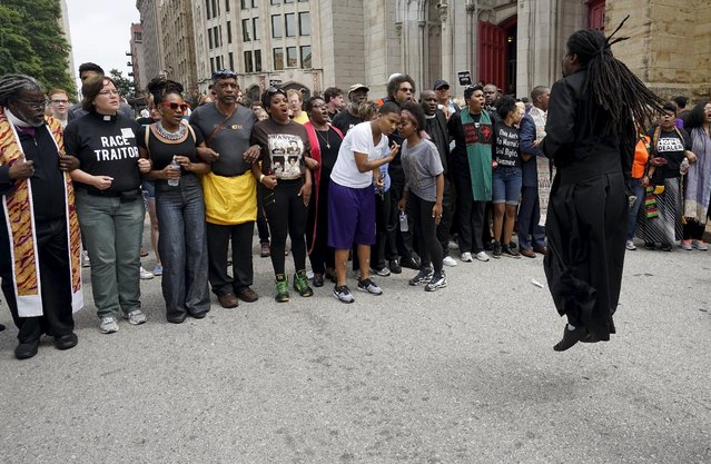 Protesters prepare to march in downtown St. Louis August 10, 2015. Authorities declared a state of emergency in Ferguson, Missouri, after gunfire erupted on the anniversary of a high-profile police shooting and prosecutors on Monday charged an 18-year-old man with assault on officers. (Photo by Rick Wilking/Reuters)