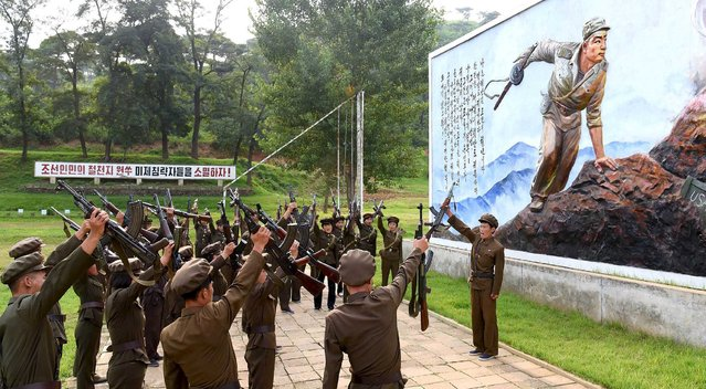 North Koreans sign up to join the army in the midst of political tension with South Korea, in this undated photo released by North Korea's Korean Central News Agency (KCNA) in Pyongyang August 23, 2015. (Photo by Reuters/KCNA)