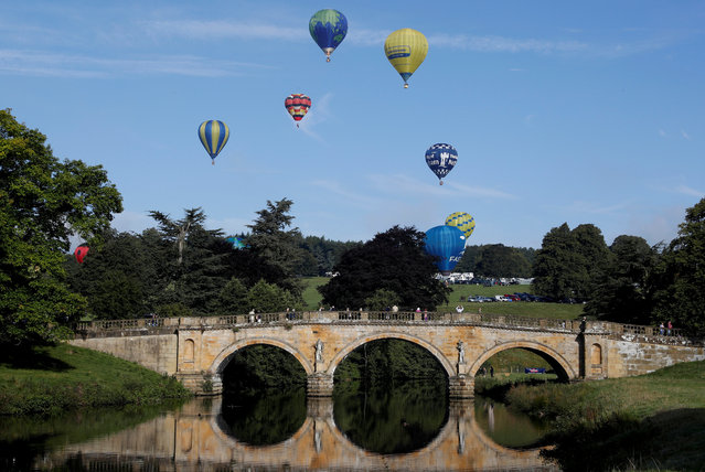 Hot air balloons take to the sky during the Chatsworth House country fair near Bakewell, Britain September 1, 2017. (Photo by Darren Staples/Reuters)