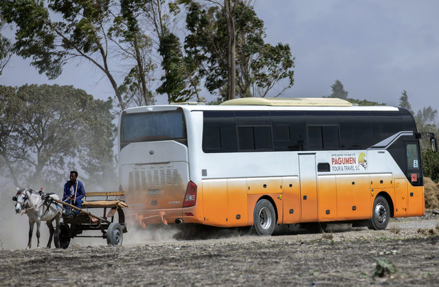 Relatives in buses arrive to attend the memorial service for the one-year anniversary of the crash of Ethiopian Airlines Flight ET302 in the rural Tulufera area near Bishoftu, south-east of the capital Addis Ababa, in Ethiopia Tuesday, March 10, 2020. Grim-faced, visibly grief-stricken, some crying, hundreds of family members gathered Tuesday for a memorial service at the site where one year ago the jet crashed into the rocky ground, killing all 157 on board. (Photo by Mulugeta Ayene/AP Photo)