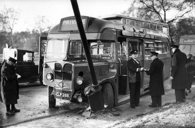 A Green Line bus at the lamppost it crashed into on Wimbledon Common, south London. 30th December 1938. (Photo by J. A. Hampton/Topical Press Agency)