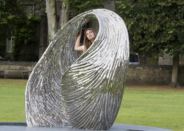 Lottie Pedder poses with Launch by Rebecaa Newham, part of Salisbury cathedral's Reflection: Glass exhibition in Salisbury, England on July 29, 2016. (Photo by David Hartley/Rex Features/Shutterstock)