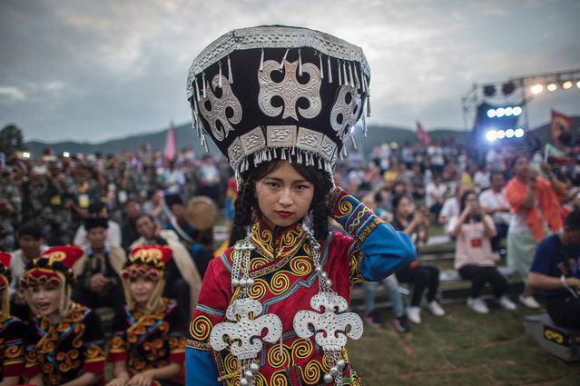 A Dancer, dressed with the traditional Yi costume, waits to perform at the Torch Festival, in Xichang, China's Sichuan province on July 27, 2016. (Photo by Fred Dufour/AFP Photo)