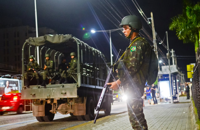 Brazilian army soldiers patrol the city to prevent gangsters from torching more government vehicles just days before the Olympic Games open in Rio de Janeiro, in the northeastern city of Natal, Brazil, August 3, 2016. (Photo by Leo Carioca/Reuters)