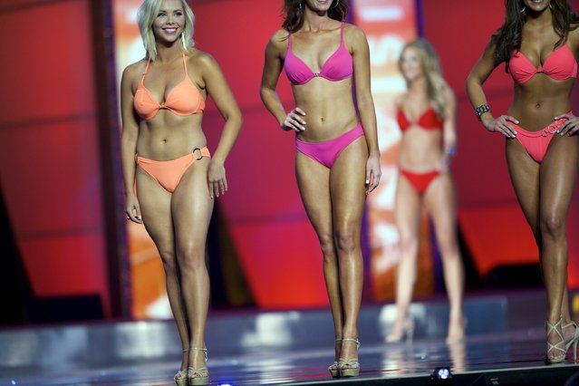 Miss America contestants compete in the swimsuit competition during the first night of preliminaries of Miss America at Boardwalk Hall in Atlantic City, New Jersey, September 8, 2015. (Photo by Mark Makela/Reuters)