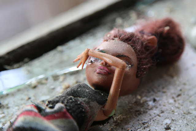 A toy doll is seen on a window sill in a damaged house in Aleksandrovka, Donetsk Region, Ukraine on May 5, 2020 after it was from shelled from an infantry fighting vehicle cannons. Three girls aged between 7 and 10 have been injured in the attack. The village of Aleksandrovka is controlled by the self-proclaimed Donetsk People's Republic, which has been in an armed conflict with the government of Ukraine since 2014. (Photo by Valentin Sprinchak/TASS)