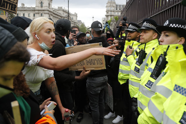 A protester yells at police during the Black Lives Matter protest rally in London, Sunday, June 7, 2020, in response to the recent killing of George Floyd by police officers in Minneapolis, USA, that has led to protests in many countries and across the US. (Photo by Frank Augstein/AP Photo)