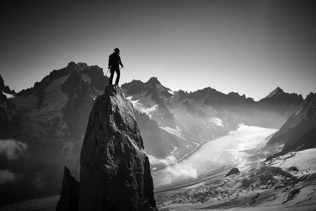 """""""Climber"""". Climbers are creatures that climb high up toward the heavens, and their hands are tools for grabbing hold of the summit. Photo location: Chamonix, France. (Photo and caption by Yosuke Kashiwakura/National Geographic Photo Contest)"""