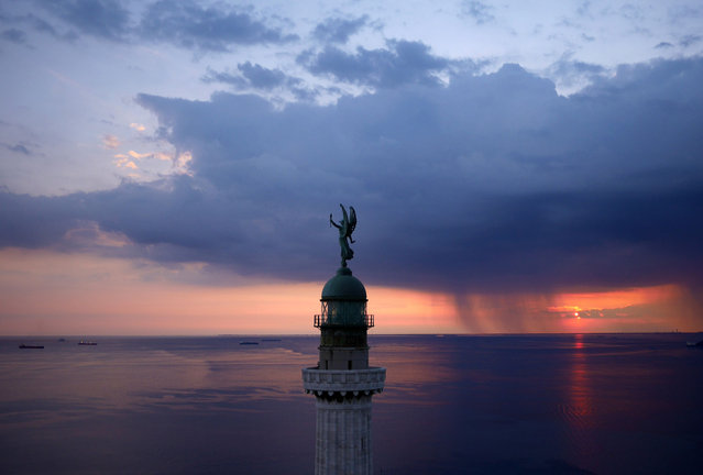 The Vittoria Light overlooking the Gulf of Trieste at sunset, Italy. (Photo by Amos Chapple/Rex Features)