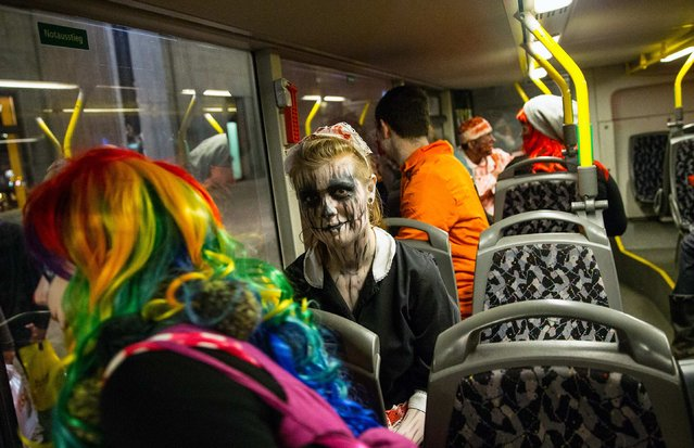 People dressed as horror figures sit in a bus as they promote at Potsdamer Platz square in Berlin a upcoming horror show at the Filmpark Babelsberg theme park October 10, 2014. (Photo by Hannibal Hanschke/Reuters)