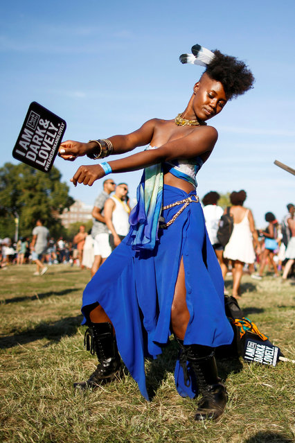 A woman dance as she takes part in the Annual Afropunk Music festival in the borough of Brooklyn in New York, U.S., August 27, 2016. (Photo by Eduardo Munoz/Reuters)