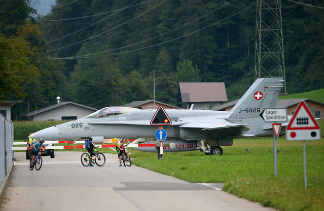 A Swiss Army Airforce F/A-18 C fighter jet taxis at the military airport in Meiringen, Switzerland August 31, 2016. (Photo by Ruben Sprich/Reuters)