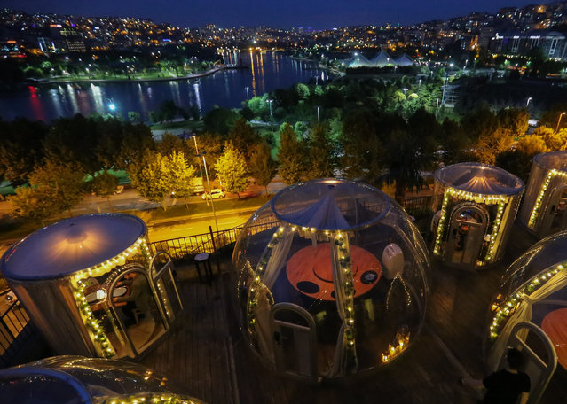 """Isolated eating areas in the shape of """"dome"""" as a measure against coronavirus (COVID-19) pandemic, are seen at a restaurant with Halic view in Istanbul, Turkey on June 16, 2020. (Photo by Esra Bilgin/Anadolu Agency via Getty Images)"""