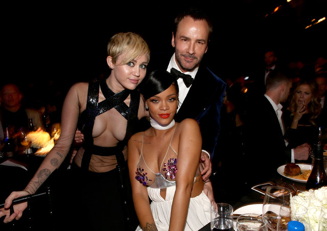 (L-R) Recording artists Miley Cyrus, Rihanna and honoree Tom Ford attend amfAR LA Inspiration Gala honoring Tom Ford at Milk Studios on October 29, 2014 in Hollywood, California. (Photo by Christopher Polk/Getty Images for amfAR)