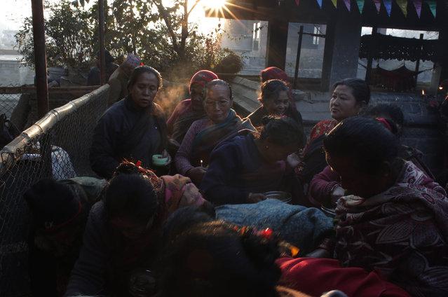 Nepalese devotees wait to offer prayer during Madhav Narayan Festival in Bhaktapur, Nepal, Tuesday, January 2, 2018. (Photo by Niranjan Shrestha/AP Photo)