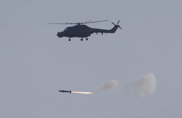 A South Korean navy helicopter LYNX fires a rocket during a media day for a naval fleet review off South Korea's southeastern coast near Busan, South Korea, Saturday, October 17, 2015. South Korea held its naval fleet review in a decade Saturday, putting state-of-art destroyers on display in a show of force amid heightened tension on the divided peninsula over North Korea's nuclear ambitions. (Photo by Ahn Young-joon/AP Photo)