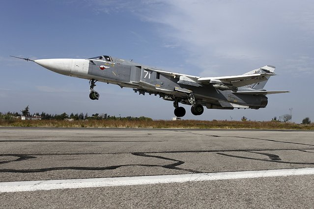 A Sukhoi Su-24 fighter jet takes off from the Hmeymim air base near Latakia, Syria, in this handout photograph released by Russia's Defence Ministry October 22, 2015. (Photo by Reuters/Ministry of Defence of the Russian Federation)