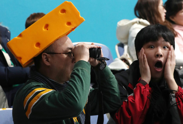 A US fan wearing a cheese hat as another fan reacts as they watch the Men's Curling Round Robin session between Canada and the US at the Gangneung Curling Centre, in Gangneung, during the PyeongChang Winter Olympic Games 2018, South Korea, 19 February 2018. (Photo by Javier Etxezarreta/EPA/EFE)