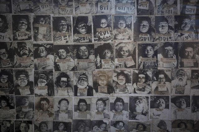 A panel displays pictures of residents who died in the 1984 Bhopal disaster at the forensic department of a hospital in Bhopal November 14, 2014. (Photo by Danish Siddiqui/Reuters)