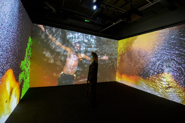 """Visitor looks at Kehinde Wiley's Narrenshschiff """"Ship of Fools"""" exhibit at The Box on September 22, 2020 in Plymouth, England. The Box Museum, a brand new multi-disciplinary arts and heritage space, will finally open on 29th September, four months later than planned due to the Coronavirus Pandemic. (Photo by Finnbarr Webster/Getty Images)"""