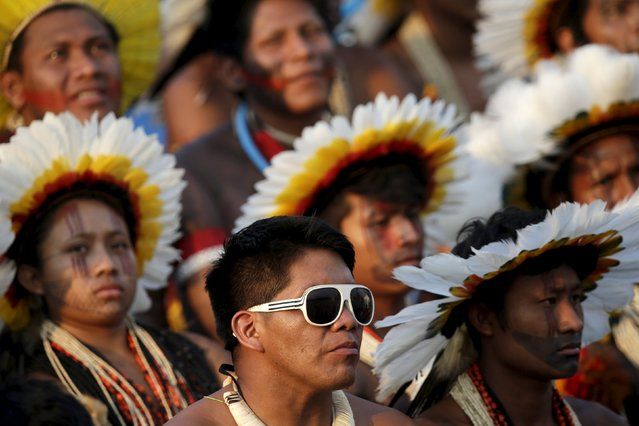 A indigenous man wears sunglasses during a presentation of the various sporting disciplines included in the first World Games for Indigenous Peoples in Palmas, Brazil, October 24, 2015. (Photo by Ueslei Marcelino/Reuters)