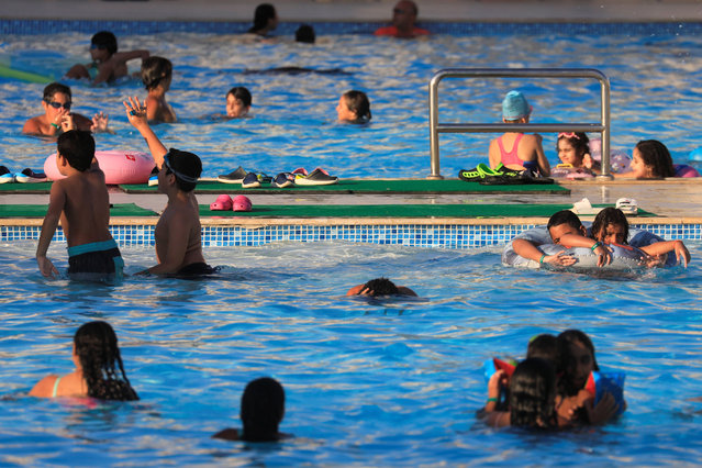 People enjoy a summer vacation on a swimming pool inside Jaz Aquaviva Hotel at a Red Sea resort, amid the coronavirus disease (COVID-19) pandemic, in Hurghada, Egypt on August 27, 2020. (Photo by Amr Abdallah Dalsh/Reuters)