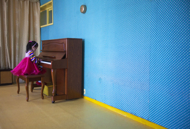 In this March 9, 2011 photo, a girl plays the piano inside the Changgwang Elementary School in Pyongyang, North Korea. (Photo by David Guttenfelder/AP Photo)