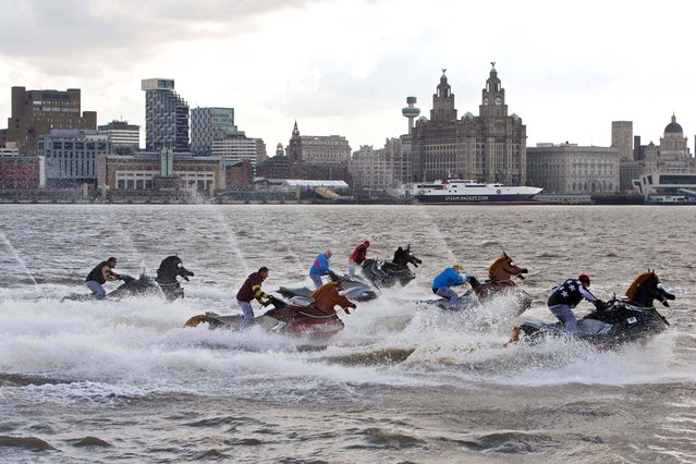 Jet Skis dressed as horses with the riders wearing the colours of the jockey silks due to race in Saturday's Grand National at Aintree, take part in The Coral National, a 500 metre race on the River Mersey in Liverpool, on April 4, 2013. (Photo by Bob Collier/PA Wire)