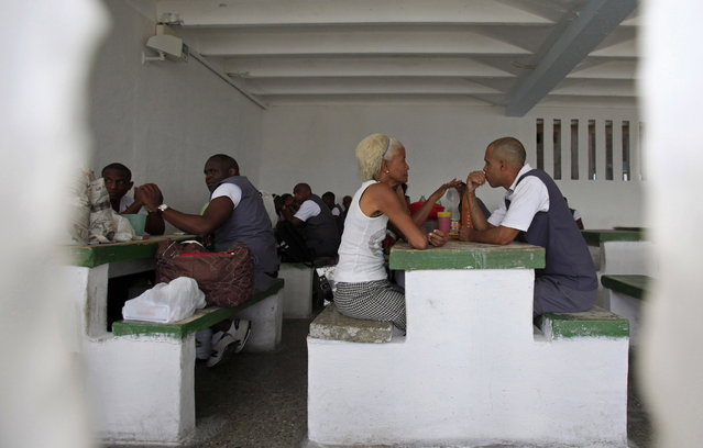 Prisoners sit with visitors during visiting hours at the Combinado del Este prison during a media tour in Havana, Cuba, Tuesday, April 9, 2013.  Cuban authorities led foreign journalists through the maximum security prison, the largest in the Caribbean country that houses 3,000 prisoners. Cuba says they have 200 prisons across the country, including five that are maximum security. (Photo by Franklin Reyes/AP Photo)
