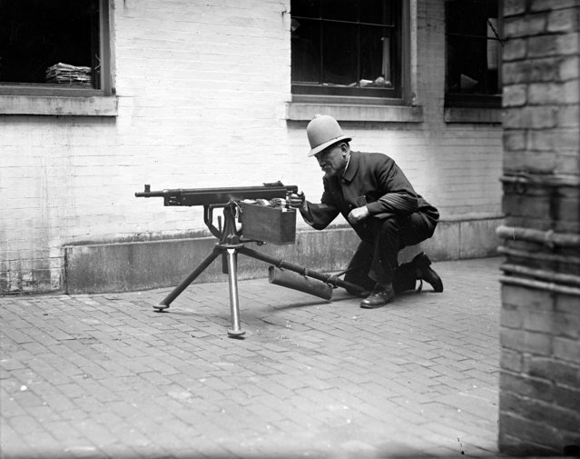 "With the latest guns, Boston police will fear nothing. The ""Reds"" will be met severely in case the start anything. 1919. (Photo by Leslie Jones)"