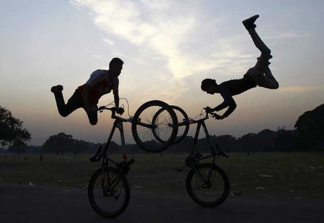 Cyclists perform a stunt as they practice ahead of the Hip-Hop Carnival in Kolkata in this December 2, 2014 file photo. (Photo by Rupak De Chowdhuri/Reuters)